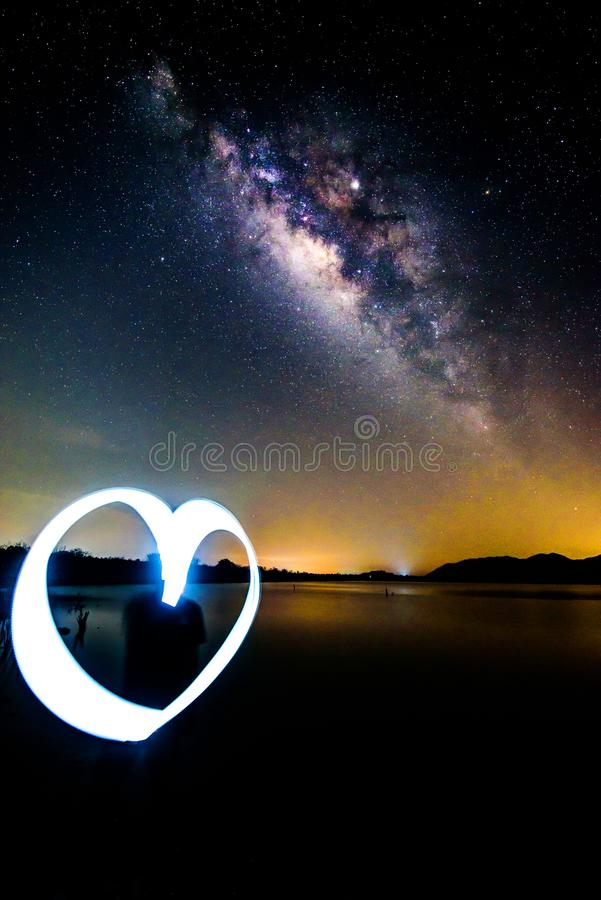 Milky way on the sky with light painting heart shape stock image