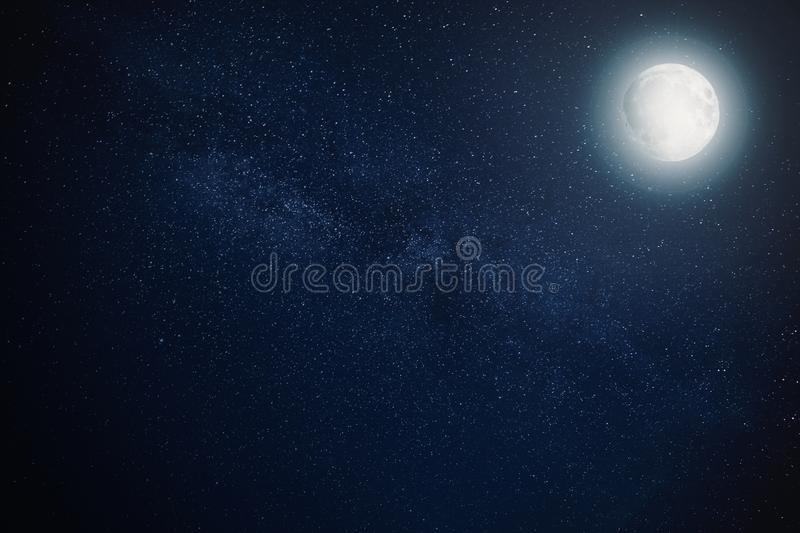Milky way star night sky with full moon royalty free stock images