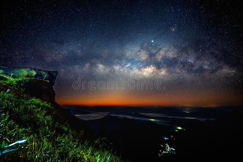 Milky way and star over Phu chi fa at night in Chiangrai, Thailand.  stock photo