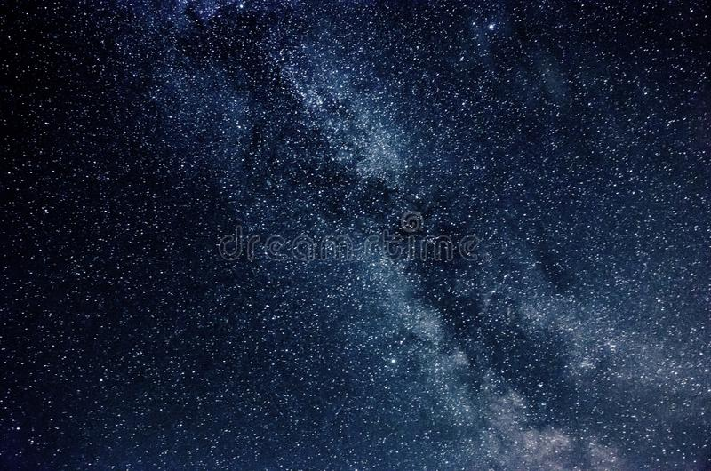 Milky Way and starry sky with clouds royalty free stock photo