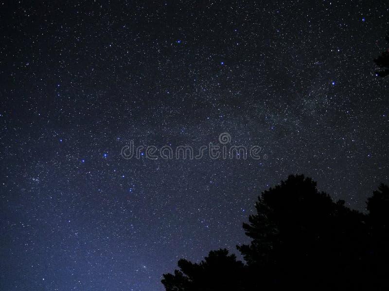 Milky way stars cassiopeia constellation on night sky royalty free stock photos