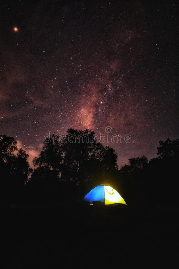 Milky way with tent royalty free stock photo