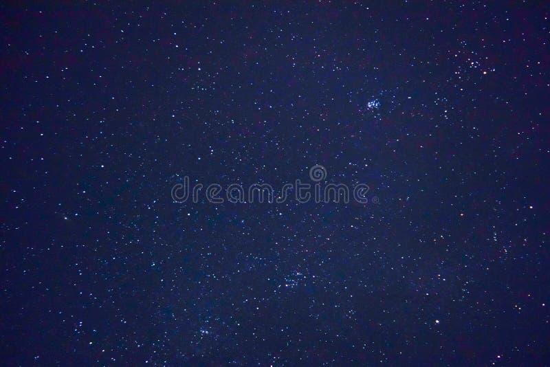 Milky way in the dark night sky stock photography
