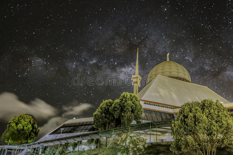 The MilkyWay and The Grand Mosque. Cloud are every where. Lucky enough to capture with open sky. The city mosque with amazing Milkyway as the background ` stock images