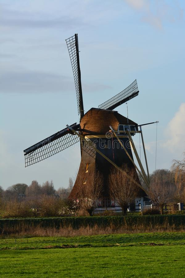 Mill in Abcoude the Netherlands. Mill in the morning sun in November Location: Gein in Abcoude in the Netherlands stock image