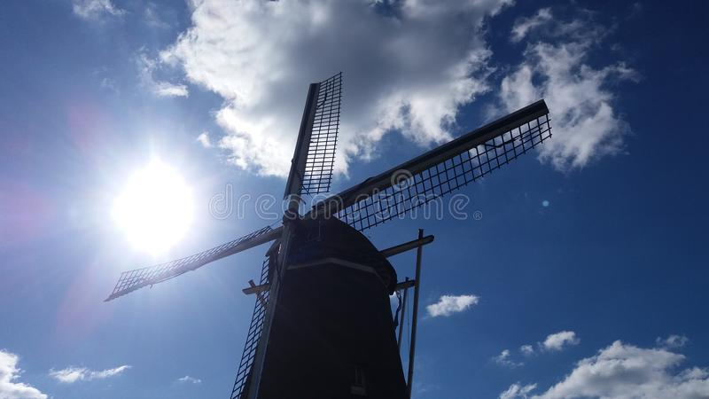 A mill against a the blue sky stock image