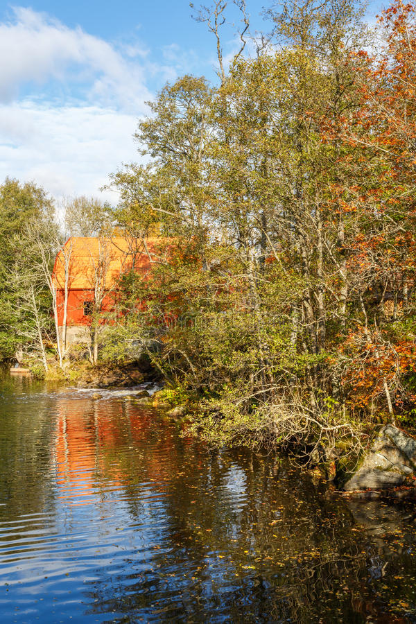 Mill at a forest lake stock image