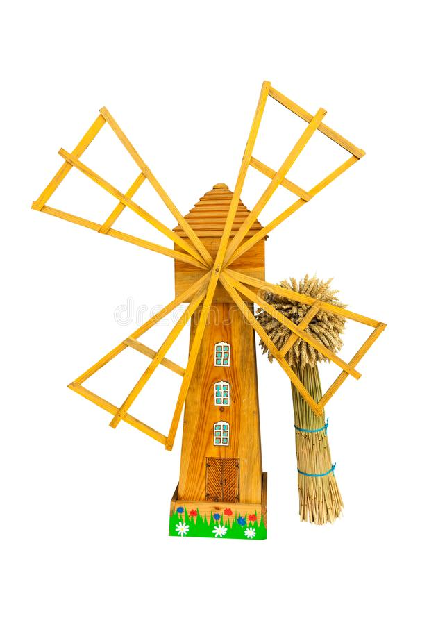 Mill Model with a sheaf. Mills model with a sheaf of wheat isolated on white background stock photography