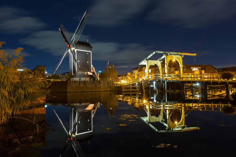 Mill and Rembrandt bridge in Leiden royalty free stock photography