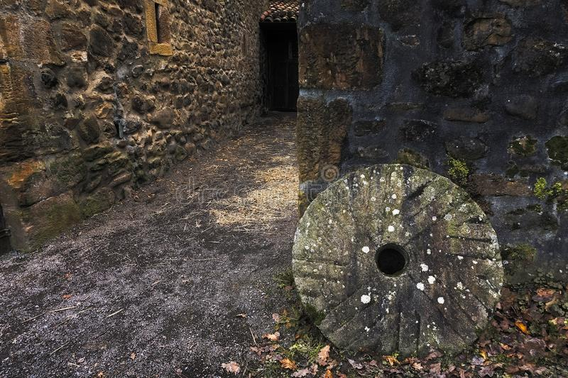 Mill stone in El Pobal ironworks royalty free stock images