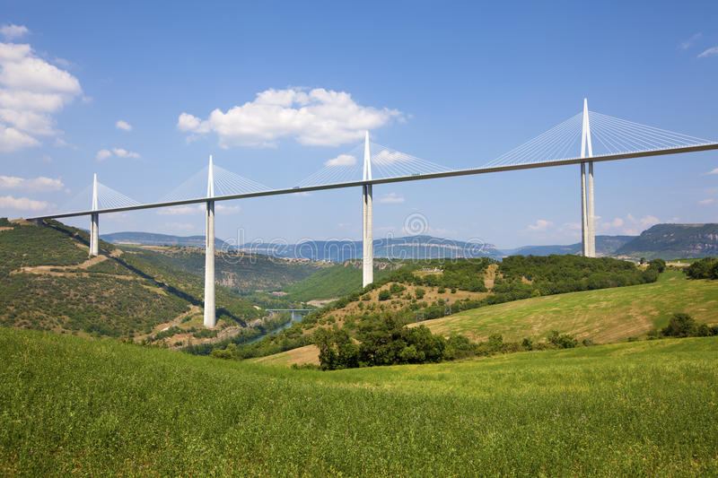 Millau Viaduct. MILLAU, FRANCE - JULY 12, 2013: View of the Millau Viaduct, the tallest cable-stayed bridge over the Tarn valley in France, designed by the stock image