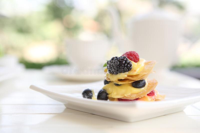 Mille feuille of berries. In close up stock photography
