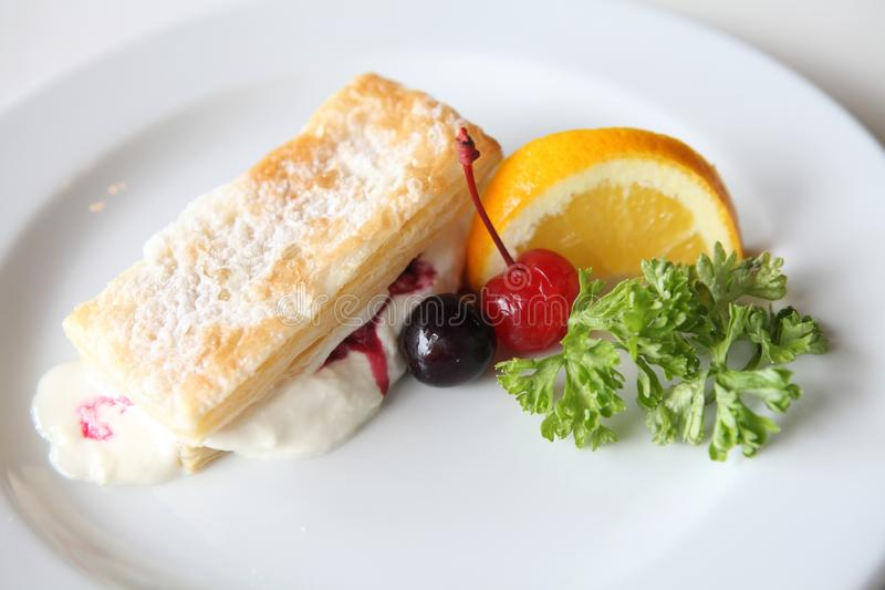 Mille feuille of berries. On a plate royalty free stock image