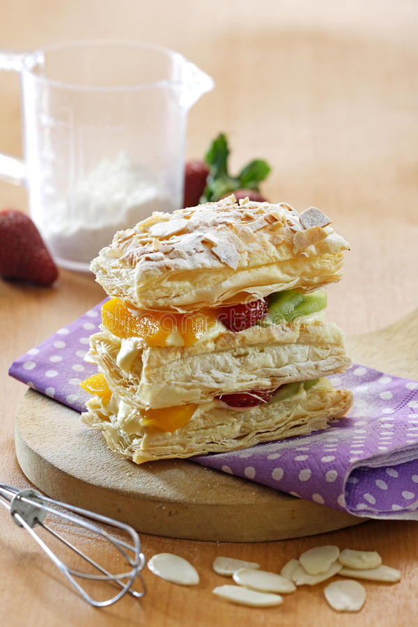 Mille feuille. With custard and fruit filling stock images