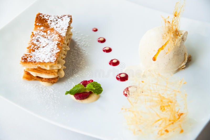 Mille Feuille, dessert. Mille Feuille, French dessert with ice-cream royalty free stock photo