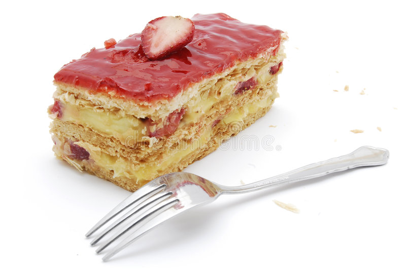 Mille-Feuille strawberry. Strawberry Mille-Feuille one piece with a fork taken in a lightbox with perfect white background royalty free stock images