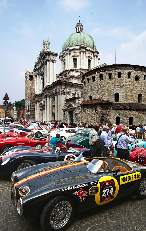 Mille Miglia. BRESCIA,ITALY - APR,14: a some cars at the puncing of Mille Miglia,the famous race for historic cars,April 14,2009 in Brescia,Italy royalty free stock photo