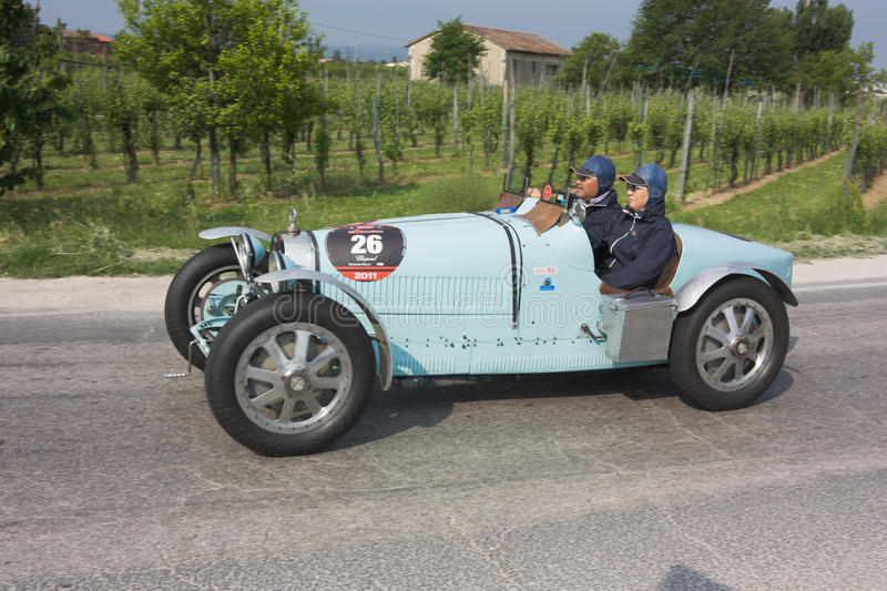 Mille miglia 2011. FORLI', ITALY - MAY 13: Kyoto Takemoto drives a Bugatti Type 35 A (1926) in stage Bologna-Roma of the Mille miglia historical race for classic stock photography