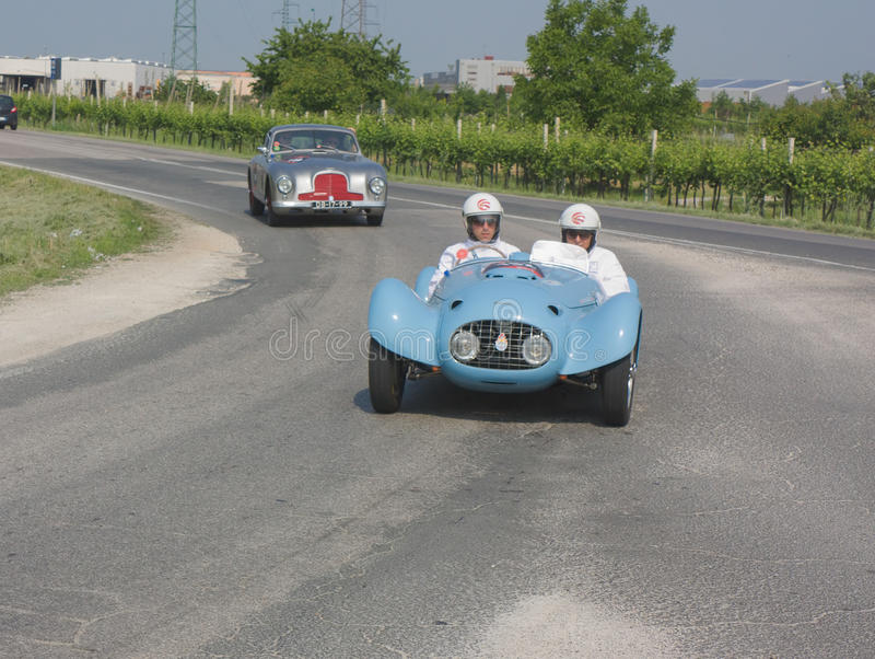 Mille miglia 2011. FORLI', ITALY - MAY 13: Gilberto and Andrea Focardi drives a Ermini 1100 sport (1950) in stage Bologna-Roma of the Mille miglia historical stock photos