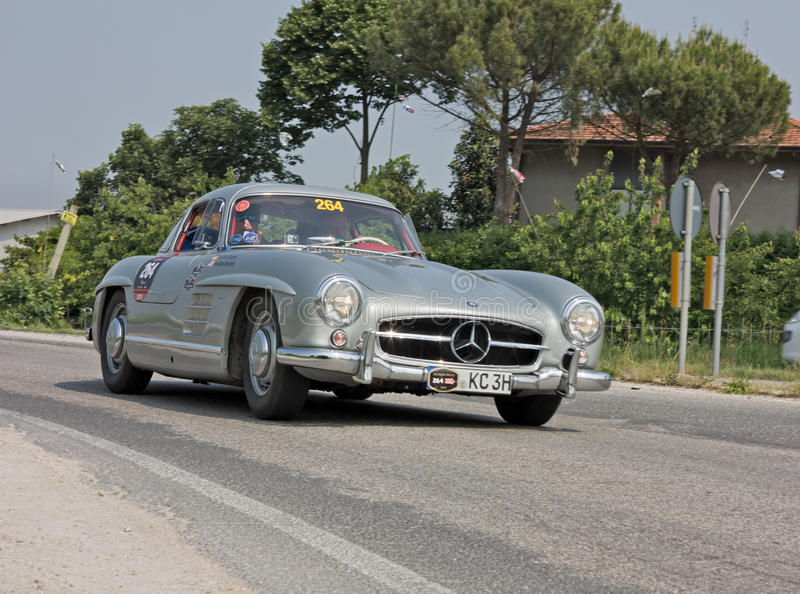 Mercedes-Benz 300 SL W198 in Mille Miglia 2011. C. Kramer and J. Weisheit drives a Mercedes-Benz 300 SL W198-I (1955) in stage Bologna-Roma of the Mille miglia royalty free stock photos