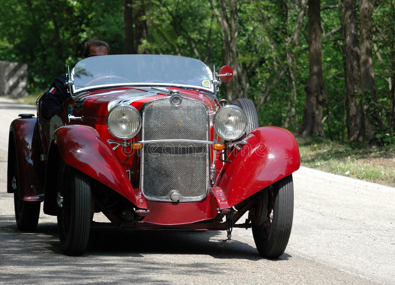 Mille Miglia race (*). Mille Miglia race along a mountain road in Italy royalty free stock photo