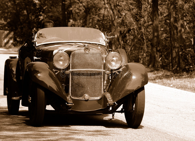 Mille Miglia race (*). Mille Miglia race along a mountain road in Italy - antiqued shot stock images