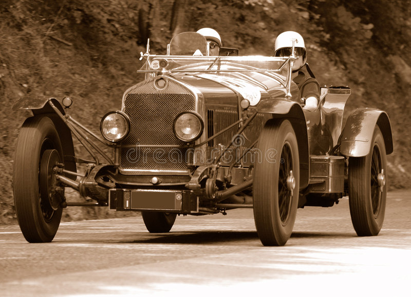 Mille Miglia race (*). Mille Miglia race along a mountain road in Italy - antiqued shot royalty free stock images