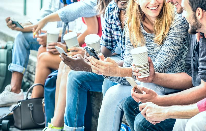 Millenial friends group using smartphone with coffee at university college - People hands addicted by mobile smart phone royalty free stock images