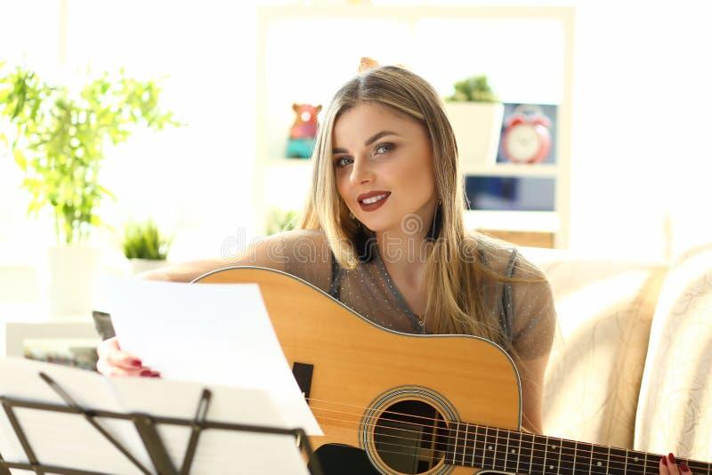 Millennial beautiful woman play guitar royalty free stock photos