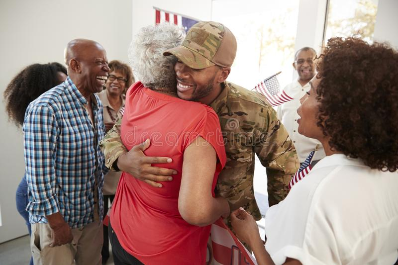 Millennial African American  soldier returning home to family embracing his grandmother,close up royalty free stock image