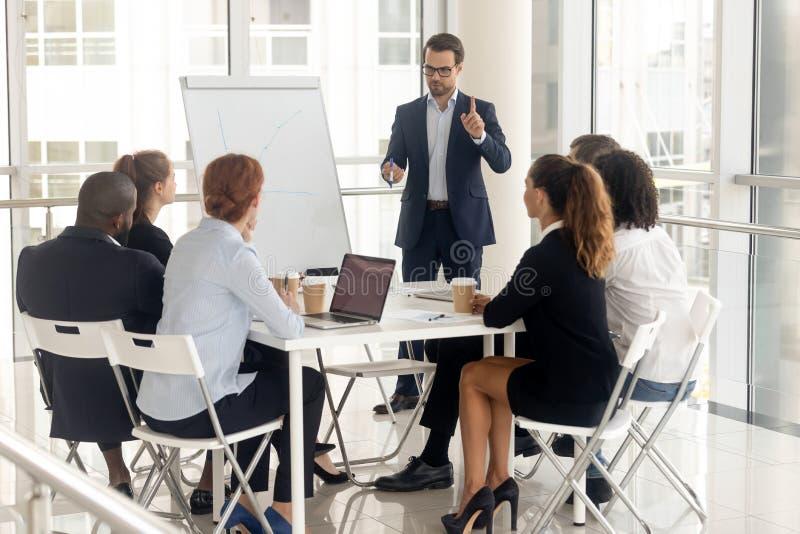 Male coach make whiteboard presentation for diverse employees stock photos