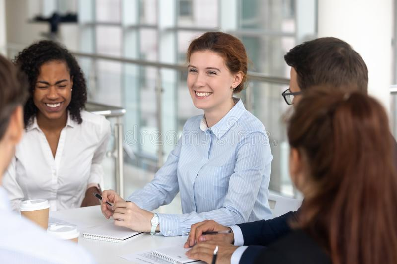 Multiracial business people take a break during negotiations joking laughing stock photography
