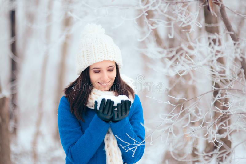 Happy Woman Playing with Snow Outdoors in Winter Portrait stock images