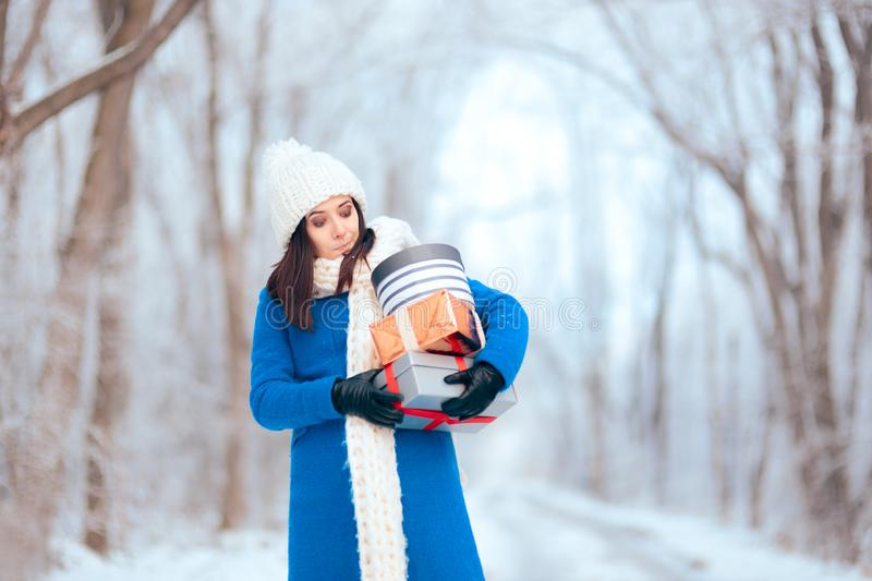 Tired Woman Carrying a Pile of Winter Christmas Gifts royalty free stock photos