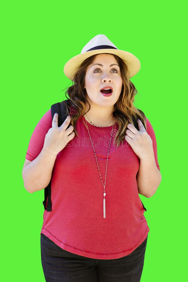 Millennial Female Carries a Backpack While Walking During Her Travels with an Amazed Expression Mouth Open Fedora royalty free stock photo