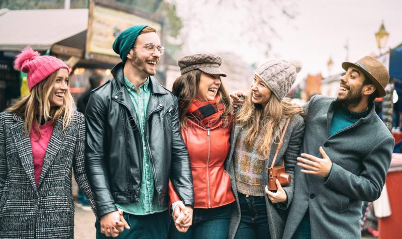 Millennial friends group walking at London city center - Next generation friendship concept on multicultural young people stock photos