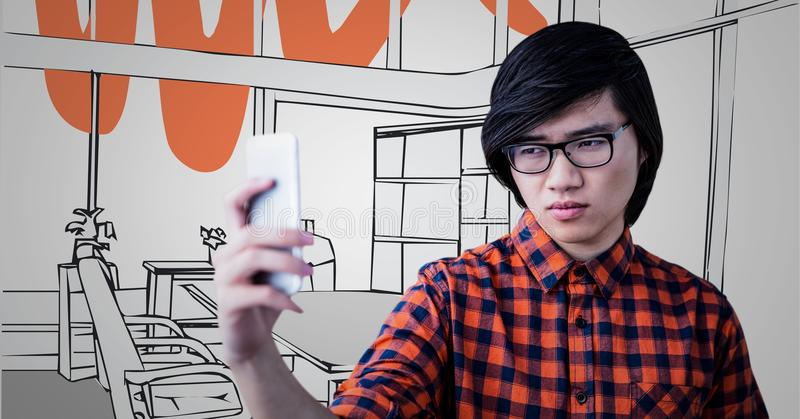 Millennial man taking selfie against grey and red hand drawn office stock photography