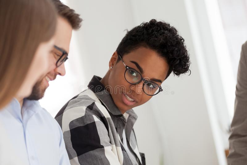 Multiracial business people in office at meeting royalty free stock photography