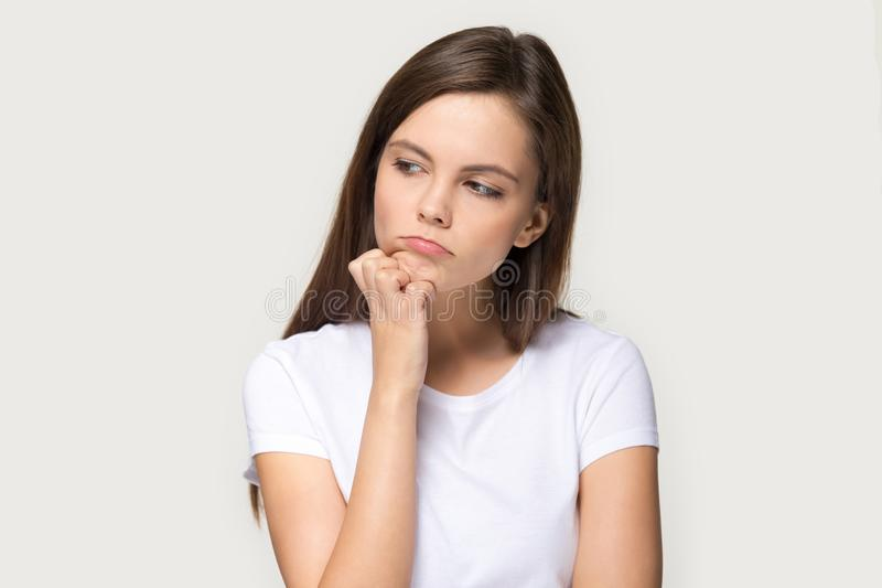 Millennial sad pensive woman feels upset isolated on grey background royalty free stock photos