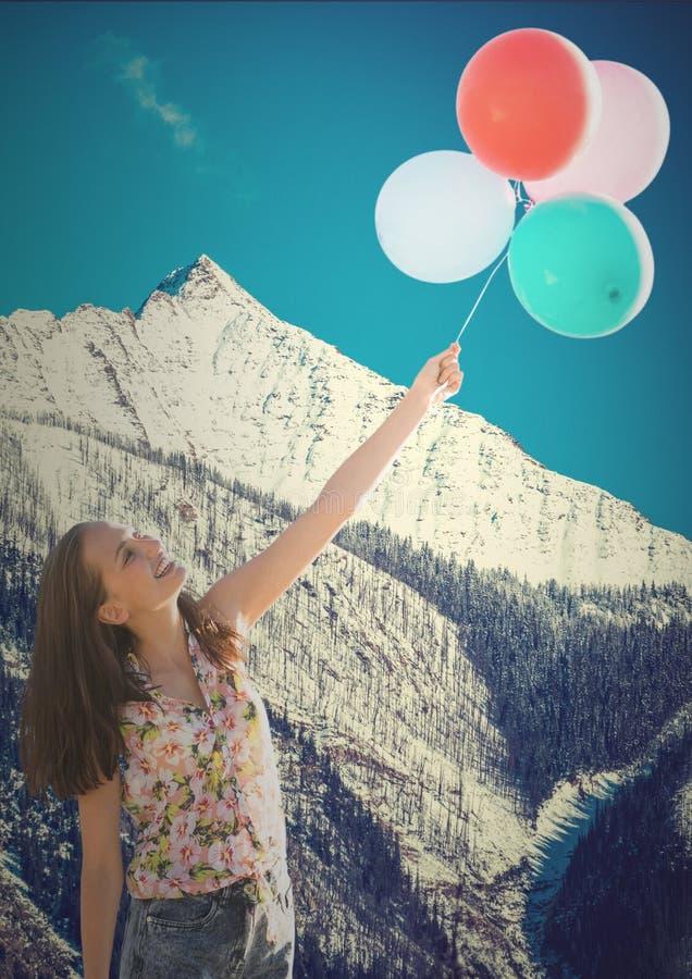Millennial vrouw met ballons tegen sneeuwberg royalty-vrije stock foto's