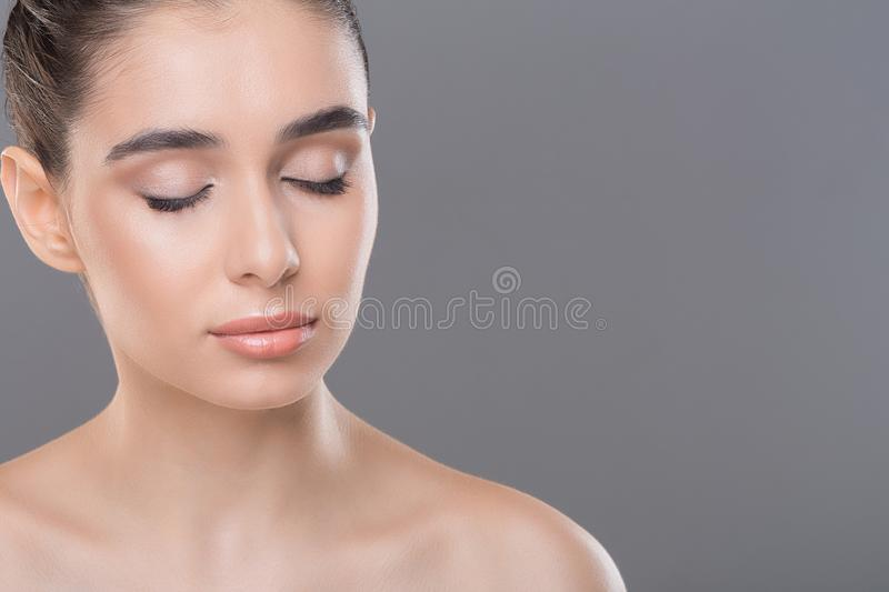 Millennial woman with perfect skin posing for makeup. Empty space royalty free stock photos