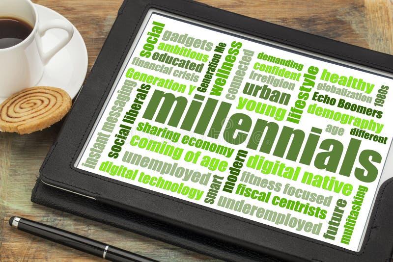 Millennials在片剂的词云彩 免版税库存照片