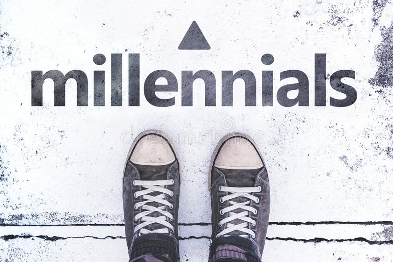Millennials concept with pair of sneakers on the pavement stock photos