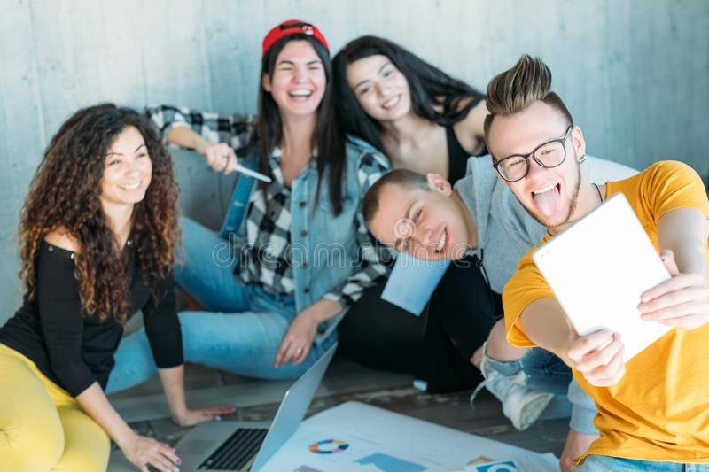 Millennials corporate atmosphere team selfie stock images