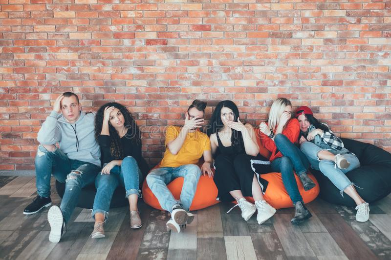 Millennials hang out relaxing lounge area bored royalty free stock photo