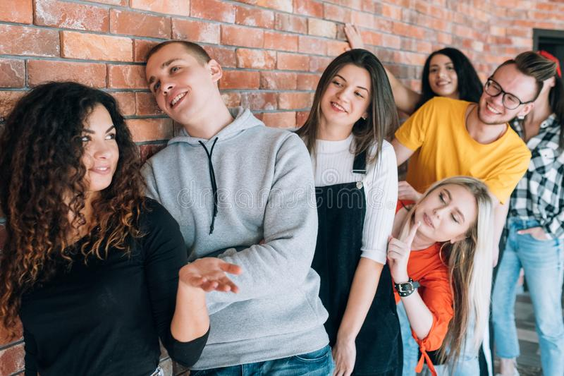 Millennials job interview business appointment. Millennials starting professional career. Young applicants having fun in queue, waiting for job interview stock photo