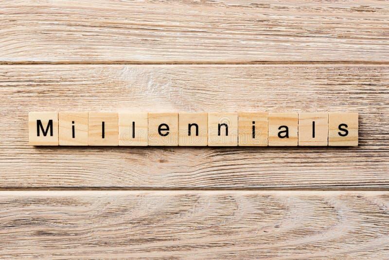 Millennials word written on wood block. millennials text on table, concept royalty free stock photos
