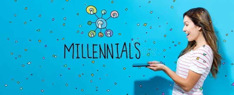 Millennials z kobietą używa pastylkę obrazy royalty free
