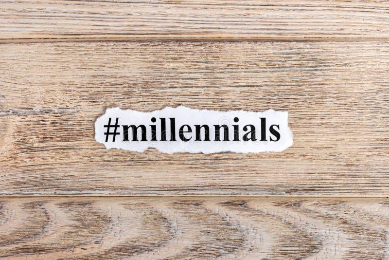 Millennialstekst op papier Word Millennials op gescheurd document Het beeld van het concept stock afbeelding