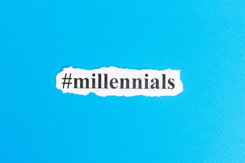Millennialstekst op papier Word Millennials op gescheurd document Het beeld van het concept stock foto's